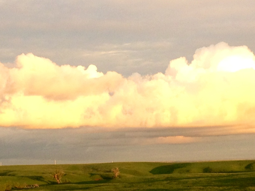 Evening sun on clouds over the ranch.
